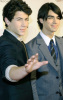 Joe Jonas and Nick Jonas arrive at the 2009 MusiCares Person of the Year Tribute in Los Angeles