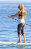 Kate Hudson paddle surfing with friends in Malibu on February 11th 2009
