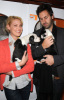 Katherine Heigl and her husband Josh Kelley playing with lil puppies during the Mutts To Melrose event on February 11th 2009 3