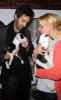 Katherine Heigl and her husband Josh Kelley playing with lil puppies during the Mutts To Melrose event on February 11th 2009 4