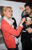 Katherine Heigl and her husband Josh Kelley playing with lil puppies during the Mutts To Melrose event on February 11th 2009 7