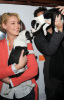 Katherine Heigl and her husband Josh Kelley playing with lil puppies during the Mutts To Melrose event on February 11th 2009 5