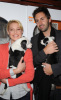 Katherine Heigl and her husband Josh Kelley playing with lil puppies during the Mutts To Melrose event on February 11th 2009 6