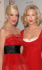 Jennie Garth with Tori Spelling attend the Heart Truth's Red Dress Collection fashion show