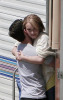 Hayden Panettiere and Milo Ventimiglia hugging on the filming set of the TV show Heroes