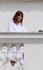 Carla Bruni Sarkozy at the balcony of her hotel room in the Copacabana Palace while on vacation on December 22nd 2008