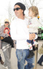 Gwen Stefani carrying Zuma along with husband Gavin Rossdale and their song Kingston