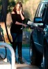 Khloe Kardashian spotted Pumping Gas into her black SUV on February 9th 2009 2
