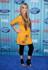 megan corkrey on the blue carpet wearing a yellow top like dress