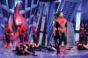 Mohamed Bash and Lara Scandar singing in a spider man tableau at the Sixth Prime of LBC Star Academy season six on March 27th 2009