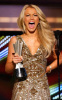 Julianne Hough gets her award at the 44th annual country music awards on April 5th 2009