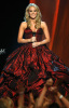 Carrie Underwood performs on stage at the 44th annual country music awards on April 5th 2009