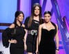 Kim Kardashian with Kourtney Kardashian and Khloe Kardashian on stage at the Bravos 2nd Annual A List Awards on April 5th 2009 2