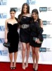 Kim Kardashian with her sisters Khloe Kardashian and Kourtney Kardashian arrive at Bravos 2nd Annual A List Awards on the 5th of April 2009 10