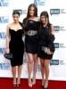 Kim Kardashian with her sisters Khloe Kardashian and Kourtney Kardashian arrive at Bravos 2nd Annual A List Awards on the 5th of April 2009 10