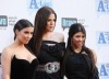 Kim Kardashian with her sisters Khloe Kardashian and Kourtney Kardashian arrive at Bravos 2nd Annual A List Awards on the 5th of April 2009 4