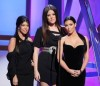 Kim Kardashian with Kourtney Kardashian and Khloe Kardashian on stage at the Bravos 2nd Annual A List Awards on April 5th 2009 3