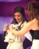 Lara Scandar holding her prize which is a cute little white puppy at Star Academy Eighth Prime on April 10th 2009