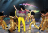 Hilda Khalife in a 70's hair wig dancing on stage with the students at the LBC Star Academy Ninth Prime