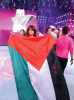 Diala Odeh with a palestinian flag as she leaves star academy on stage of the LBC Star Academy Ninth Prime