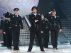 Bash from Syria singing onstage with a police outfit on the 10th prime of staracademy season 6
