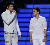 High Quality wallpaper of Adam Lambert and Kris Allen on stage of American Idol season Finale on May 20th 2009 2
