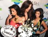kim kardashian attends the DASH Miami Store Launch on the 20th of May 2009 with her sisters Khloe Kardashian and Kourtney Kardashian 6
