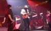 Adam Lambert and Kris Allen performing with Santana on stage