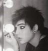 Adam Lambert backstage putting makeup