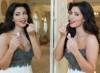 Kim Kardashian photos from the 2009 Photo Session at The LHermitage Hotel in Monte Carlo france wearing red lip gloss
