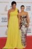 Kim Kardashian arrives on the red carpet of the 49th Annual Monte Carlo Television Festival Closing Ceremony on 11th June 2009 wearing a glam strapless silver dress with her morther Kris Jenner in the long yellow dress