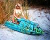 Linda Sobek modeling at the beach