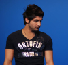 Ibrahim Dashti Professional Photoshoot in a black printed tshirt