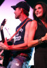 James Denton and Teri Hatcher perform onstage during the 2nd Annual Band From TV Night held at Cal State Fullerton Titan Stadium on July 26th 2008 in Fullerton California 1
