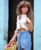 Thalia high quality picture from the 1992 latin drama series Maria Mercedes with a basket of flowers