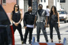 The Black Eyed Peas pose together during a photo shoot downtown in July 2009 2