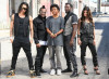 The Black Eyed Peas pose together during a photo shoot downtown in July 2009 3