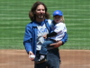 Eddie Vedder holds his daughter Olivia at a baseball game between the San Diego Padres and Chicago Cubs on May 14th 2006 in Chicago 1