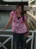 Aya Abdel Raoof picture wearing a pink top over denim blue pants 3