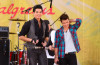 Kris Allen with Adam Lambert performing on stage during Good Morning America at Rumsey Playfield Central Park on August 7th, 2009 in New York City
