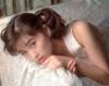Noriko Sakai photo shoot sleeping on a pillow