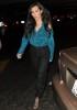 Kim Kardashian photo at LAX Airport weaing a blue satin shirt and black pants on July 29th 2009 5