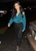 Kim Kardashian photo at LAX Airport weaing a blue satin shirt and black pants on July 29th 2009 1