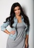 Kim Kardashian professional Photoshoot of August 2009 wearing a cotton mini grey dress under a denim jacket 2