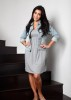 Kim Kardashian professional Photoshoot of August 2009 wearing a cotton mini grey dress under a denim jacket 1