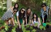 Kim Kardashian picture with her mother Kris Jenner and sisters Kourtney and Khloe Kardashian planting a vegetable garden on August  6th 2009 3