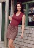 Terry Farrell wearing a gray skirt and a dark pink blouse