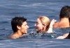 Madonna and Jesus Luz picture while swimming together in the ocean on August 17th 2009 3