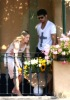 Jesus Luz picture as he wishes Madonna a happy birthday in the morning of August 17th 2009 and gives her a bouquet of sunflowers