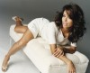 Eva Longoria Desktop wallpaper laying on a white mini couch wearing a white dress